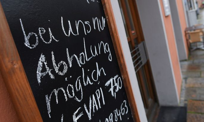 A sign reading 'Take away only from October 27' is seen in the city center prior to an ordered lock-down due to the further spreading of the coronavirus disease (COVID-19) in Pfarrkirchen