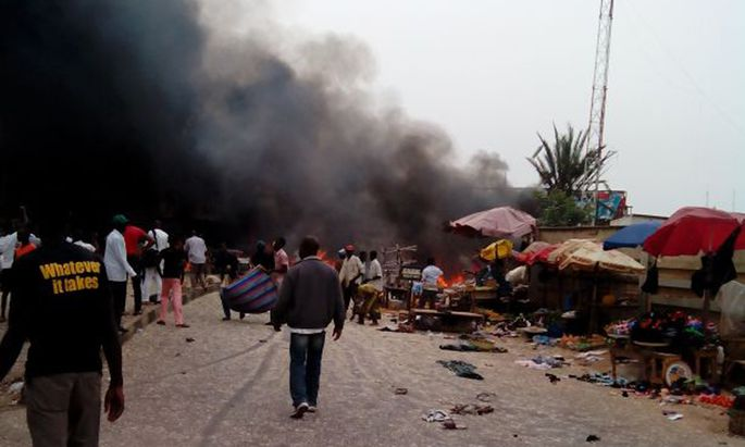 Smoke rises after a bomb blast at the market district in Jos