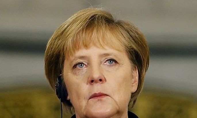 German Chancellor Merkel attends a news conference with Romanias President Basescu (unseen) at Cotros President Basescu (unseen) at Cotro