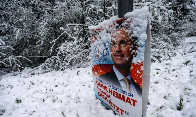 A banner of Austrian presidential candidate Norbert Hofer is covered with snow in Gnadenwald