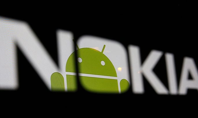 A partial view of an Android logo displayed on a LCD screen is seen through a Nokia logo in the central Bosnian town of Zenica