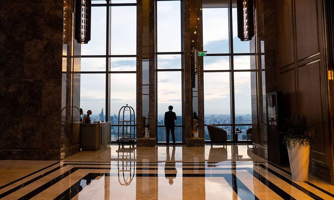 A man is silhouetted in a marble lobby of a luxury hotel in Ho Chi Minh City Vietnam on August 23