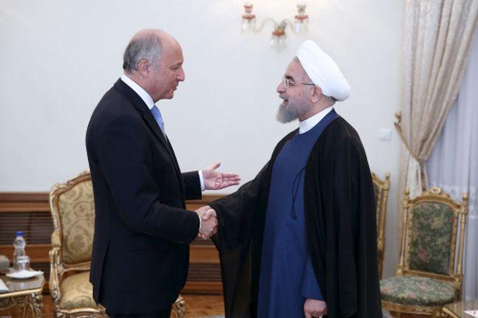 Präsident Rohani (re) begrüßt Außenminister Fabius