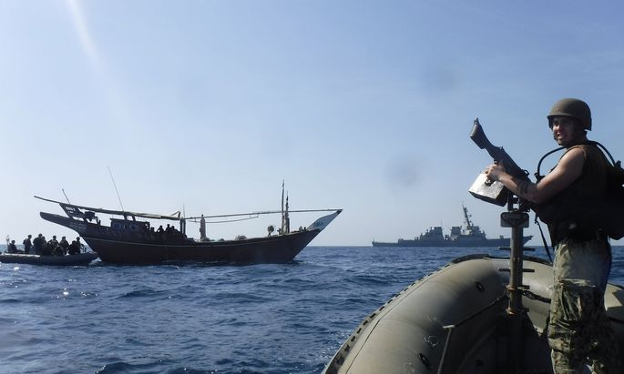 The Arleigh Burke-class guided-missile destroyer USS McFaul's (DDG 74) visit, board, search and seizure team pulls alongside a Bahraini dhow during routine maritime security operations in the Arabian Gulf
