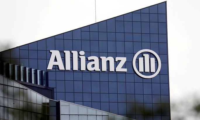 FILE PHOTO: The logo of insurer Allianz SE is seen on the company building in Puteaux at the financial and business district of La Defense near Paris, France