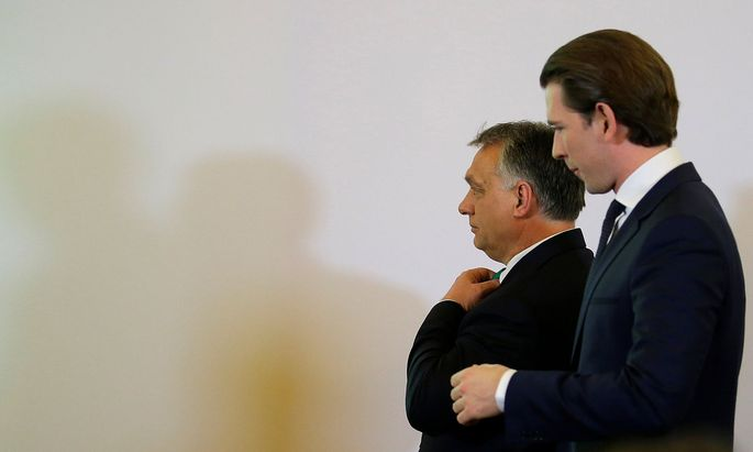 Hungary's Prime Minister Orban and Austria's Chancellor Kurz leave a news conference in the chancellery in Vienna