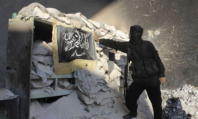 A Fighter from Islamist Syrian rebel group Jabhat al-Nusra poses at checkpoint in Aleppo´s Bustan al-Qasr