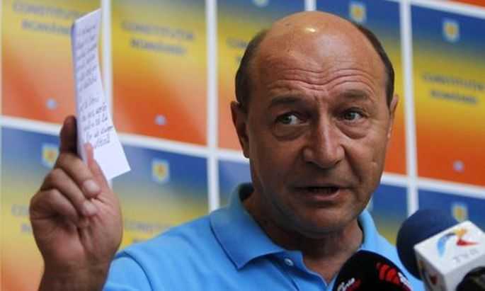 Romania's suspended President Basescu addresses the media in Bucharest