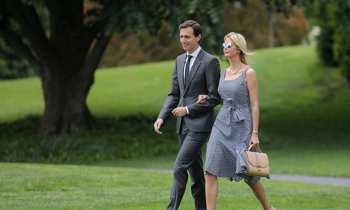 Ivanka Trump and her husband walk along the South Lawn of the White House as they accompanied U.S. President Donald Trump before his departure to New York