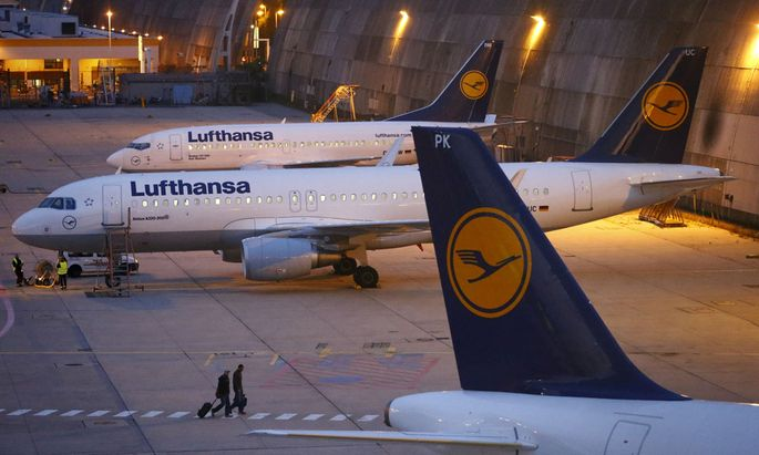Passenger planes of German air carrier Lufthansa are parked at the technical maintaining area at the Frankfurt Airport