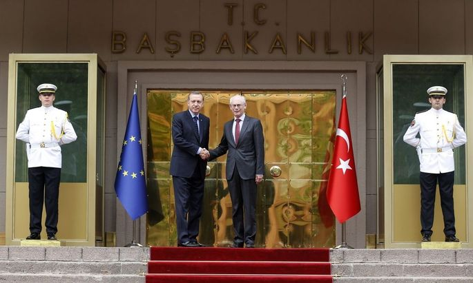 European Council President Van Rompuy shakes hands with Turkey's Prime Minister Tayyip Erdogan during a welcoming ceremony in Ankara