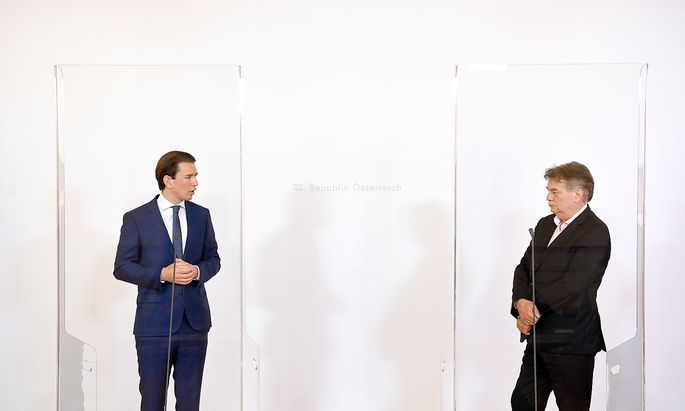 Austrian Chancellor Kurz and Vice-Chancellor Kogler attend a news conference during the coronavirus disease (COVID-19) outbreak in Vienna