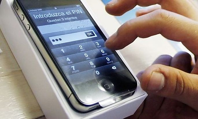 A customer assigns a PIN number to his new iPhone 4 at a Telefonica store in Madrid
