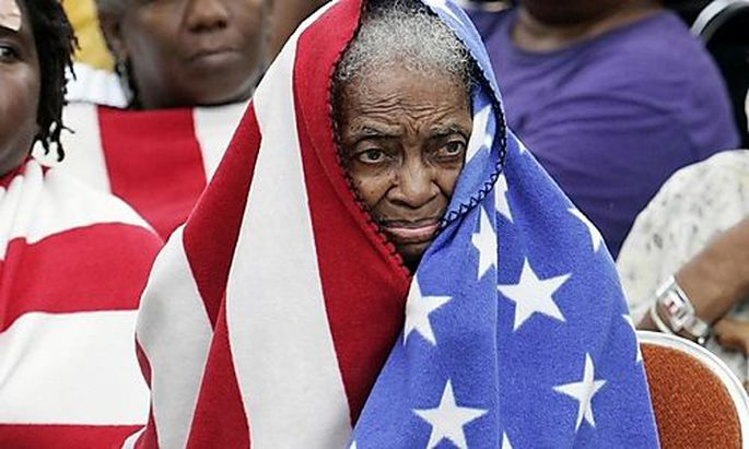 FILE - In this Thursday, Sept. 1, 2005 picture, Milvertha Hendricks, 84, covered with a blanket depic