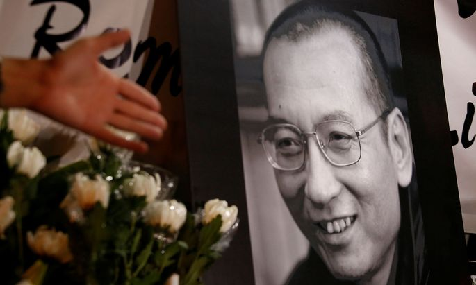 Flowers are laid beside a photo of the late Nobel Laureate Liu Xiaobo in Hong Kong
