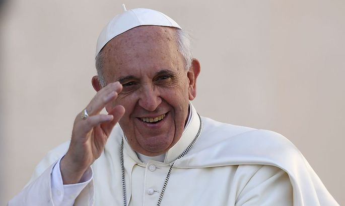 Pope Francis waves as he arrives to lead his Wednesday general audience in Saint Peter's Square at the Vatican
