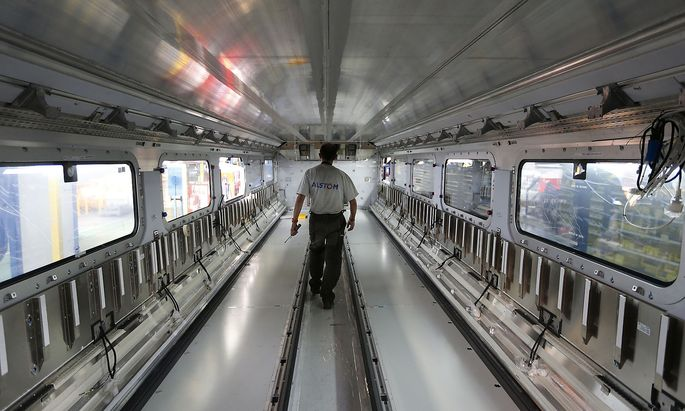 An employee of French engineering group Alstom works on an Euroduplex TGV train (high speed train) at the plant in Aytre near La Rochelle