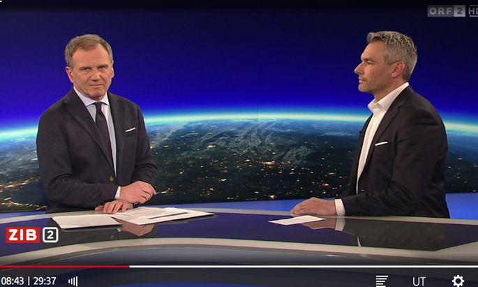 """Moderator Armin Wolf und ÖVP-Innenminister Karl Nehammer am Montag in der """"ZiB2"""""""