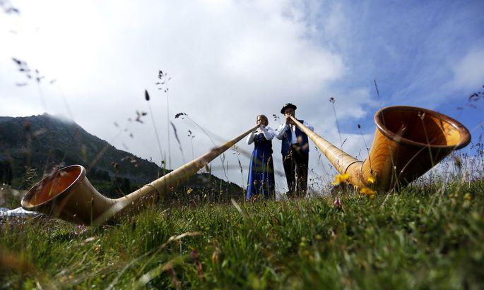 Alphorn blowers perform an ensemble piece on the last day of the International Alphorn Festival on Lac de Tracouet near the village of Nendaz