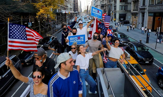 A group of friends who live in New York City celebrate after former Vice President Joe Biden was declared the winner of the 2020 U.S. presidential election