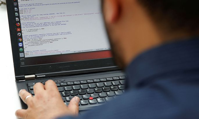 A student works in his web development class as part of professional training at the Simplon.co school specialized in digital sector in Montreuil, near Paris