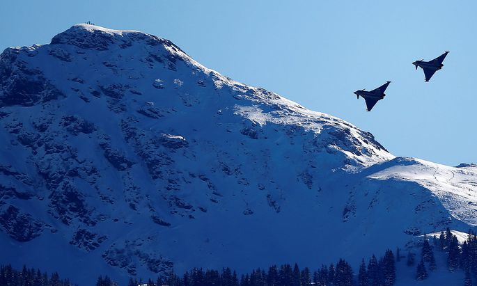 FILE PHOTO: Two Eurofighter Typhoon aircraft fly over the Streif course during an aerial exhibition before the start of the men´s Alpine Skiing World Cup Super G race in Kitzbuehel