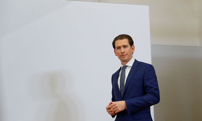 Head of OeVP Kurz arrives for a meeting in Vienna