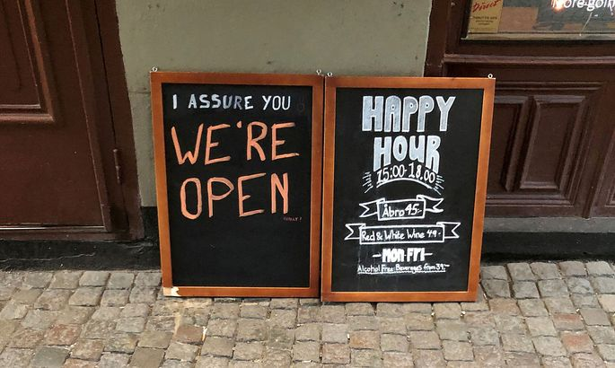 FILE PHOTO: Sign assures people that bar is open during coronavirus outbreak in Stockholm
