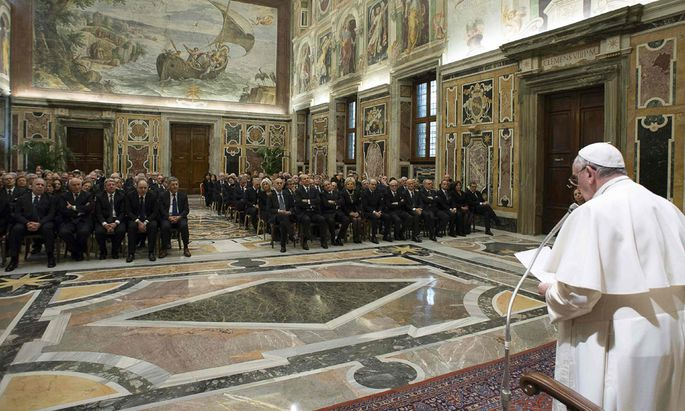 Pope Francis speaks as he leads a meeting with Italian prefects at the Vatican