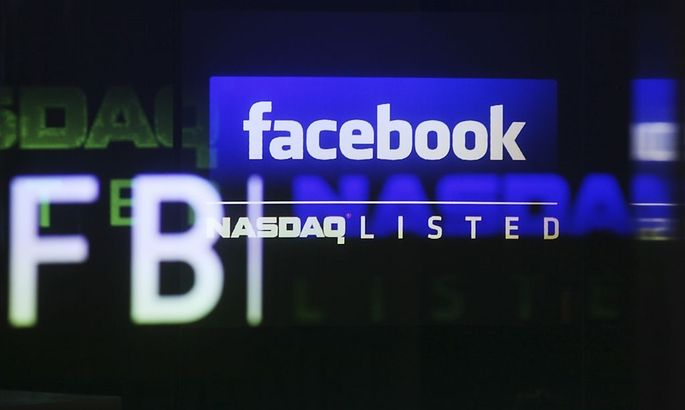 File photo of the Facebook logo on a screen inside at the Nasdaq Marekstsite in New York