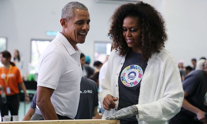 Former U.S. President Barack Obama and former first lady Michelle Obamaattend a community service project in Petaling Jaya