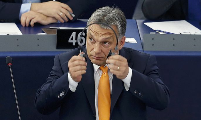 Hungarian Prime Minister Orban arrives to attend a debate on the situation in Hungary at the European Parliament in Strasbourg