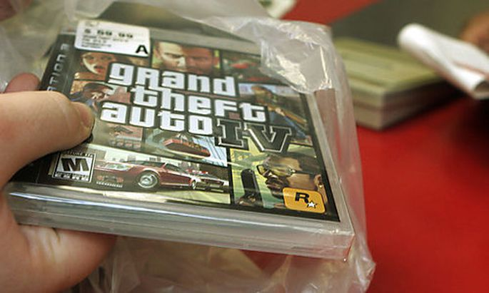 ** FILE ** In this April 29, 2008 file photo, a clerk bags a copy of Grand Theft Auto IV at a Circuit