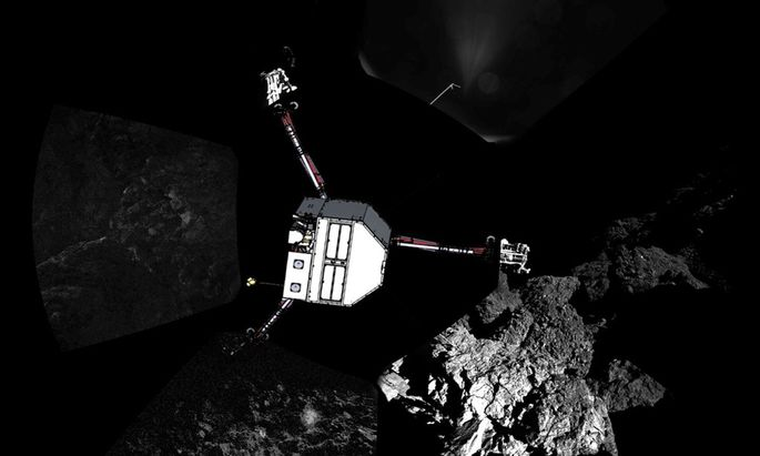 ESA handout image shows a panoramic image of the surface of Comet 67P/Churyumov�Gerasimenko with a sketch of the lander in the configuration the lander team currently believe it is in superimposed on top
