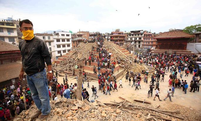 Rescue workers inspect the rubble of a building for possible survivors in Kathmandu Nepal on April