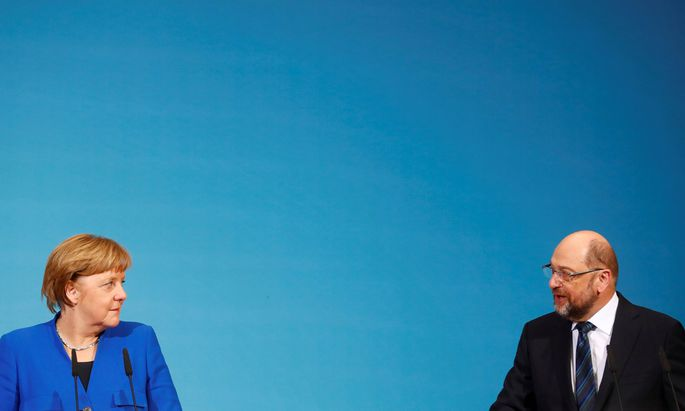 Kampf um eine Regierungsbildung. Die Partei von Martin Schulz, die SPD, soll Angela Merkel (CDU) nach 2005 und 2013 erneut zur Kanzlerin machen.