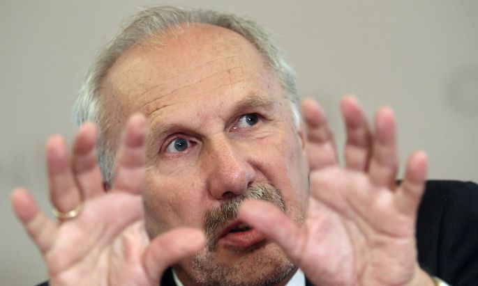 European Central bank policymaker and head of the Austrian National Bank Nowotny addresses a news conference in Vienna