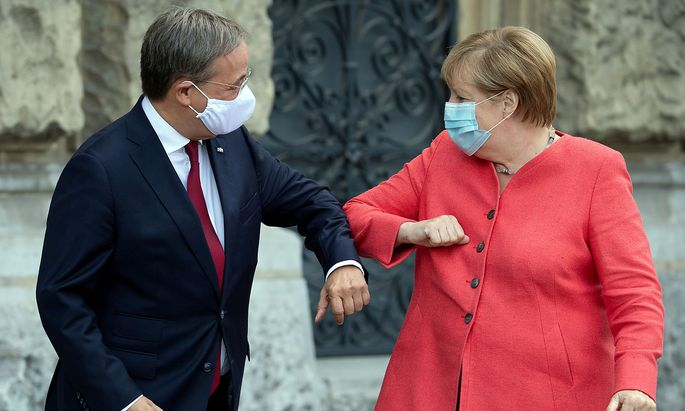 FILE PHOTO: German Chancellor Merkel meets Armin Laschet in Duesseldorf