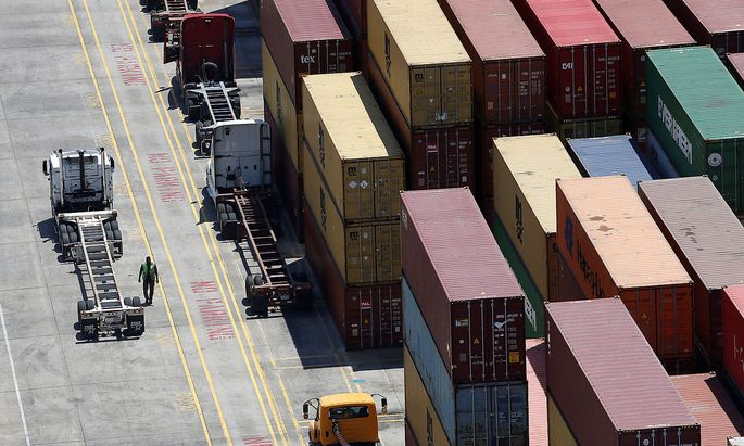FILE PHOTO: Workers stack empty shipping containers for storage at Wando Welch Terminal operated by the South Carolina Ports Authority in Mount Pleasant