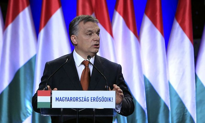 Hungarian Prime Minister Orban gestures during his annual state-of-the-nation speech in Budapest
