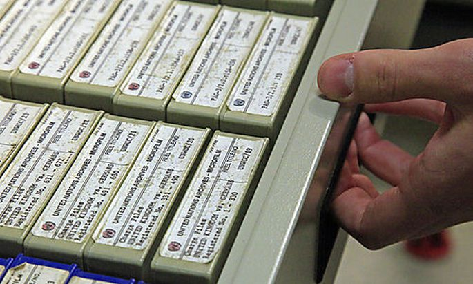 In this Thursday, Feb. 23, 2012 photo, a researcher in New York opens a drawer containing some of the