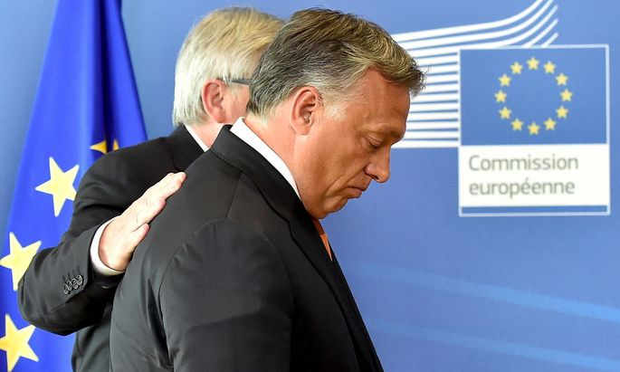 Hungary´s PM Orban is welcomed by EC President Juncker ahead of their meeting at the European Commission headquarters in Brussels