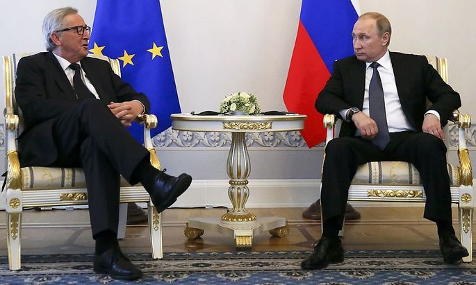 Russian President Putin meets European Commission President Juncker in St. Petersburg