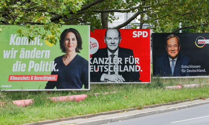 Top candidates for the German Chancellery feature on election campaign billboards
