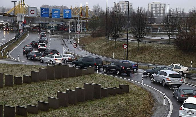 Cars queue before leaving Switzerland in front of a checkpoint at the Swiss-German border in the northern Swiss town of Kreuzlingen