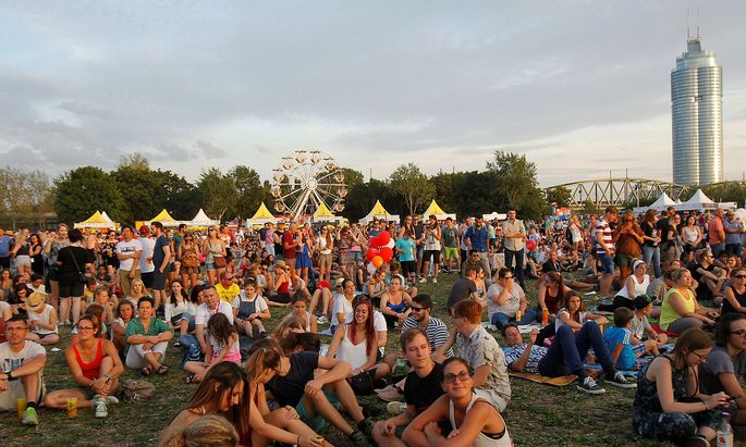 Visitors relax at Donauinselfest open air festival in Vienna