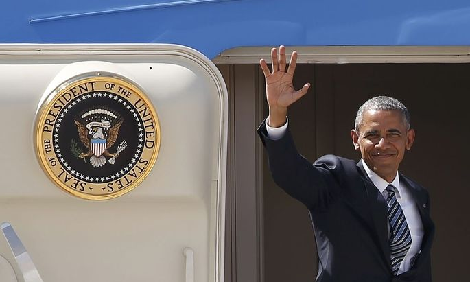U.S President Obama waves as he boards Air Force One at the Torrejon airbase, outside Madrid