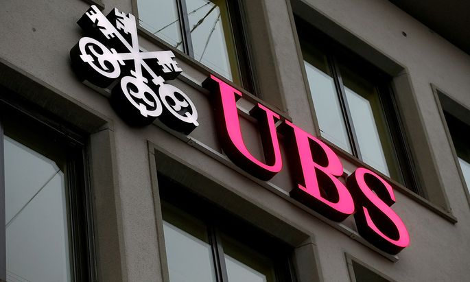 FILE PHOTO: Logo of Swiss bank UBS is seen at an office building in Zurich