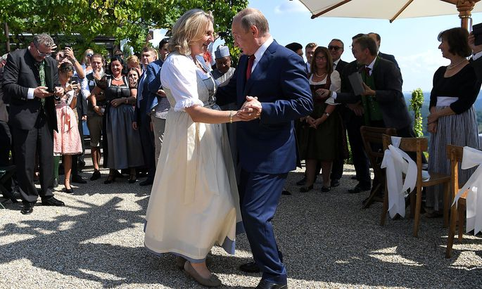 Austria's Foreign Minister Kneissl dances with Russia's President Putin at her wedding in Gamlitz