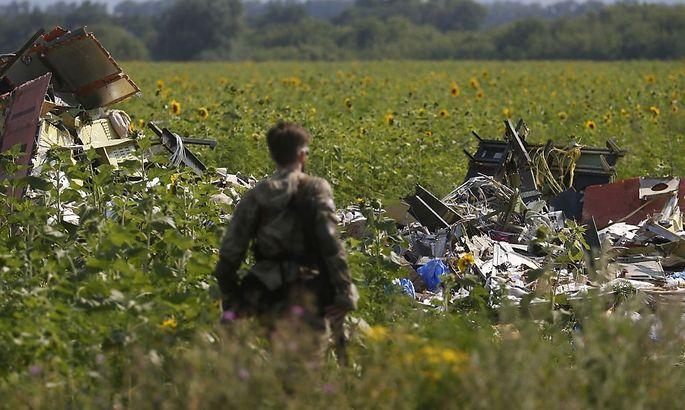 Ein Pro-russischer Separatist mitten im Trümmerfeld